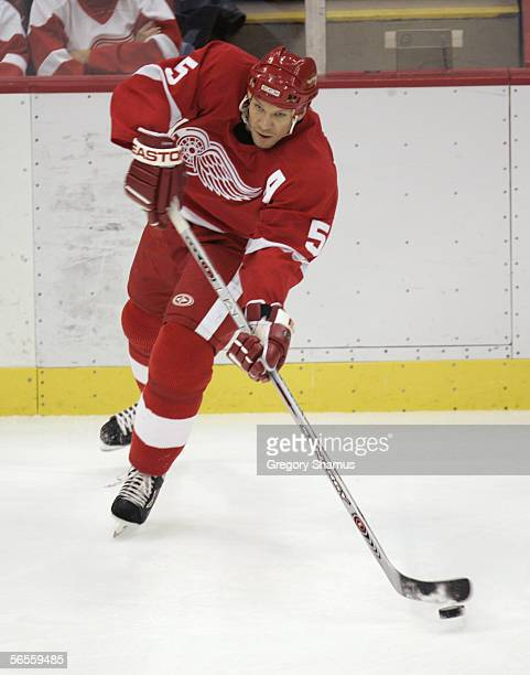 Nicklas Lidstrom of the Detroit Red Wings skates with the puck during the game against the Columbus Blue Jackets at Joe Louis Arena on December 20...