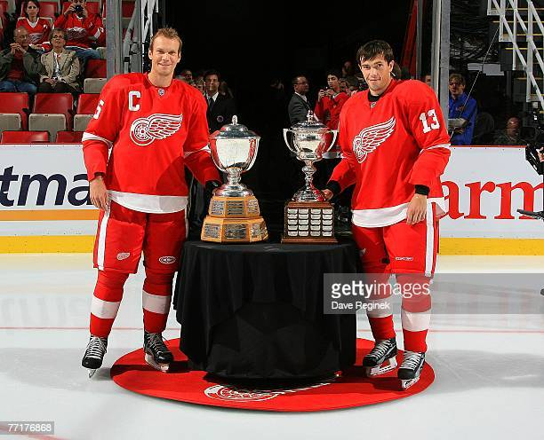 Nicklas Lidstrom of the Detroit Red Wings stands by the NHL Norris trophy awarded to him for the NHL's best defenseman during the 2006-07 season and...