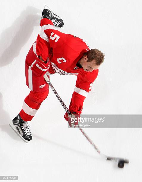 Nicklas Lidstrom of the Detroit Red Wings takes a slap shot in warmups before the NHL game against the Colorado Avalanche on February 1 2008 at Joe...