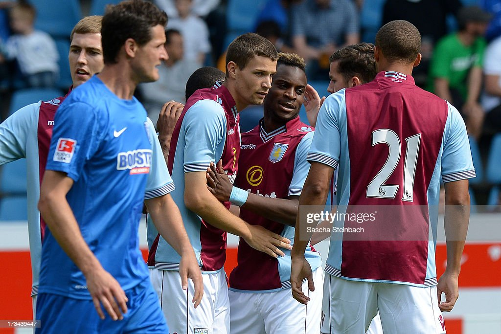 Nicklase Helenius (C) of Aston Villa celebrates after scoring the opening goal with team mates during the pre-season friendly match between VfL Bochum and Aston Villa at Rewirpower Stadium on July 14, 2013 in Bochum, Germany.