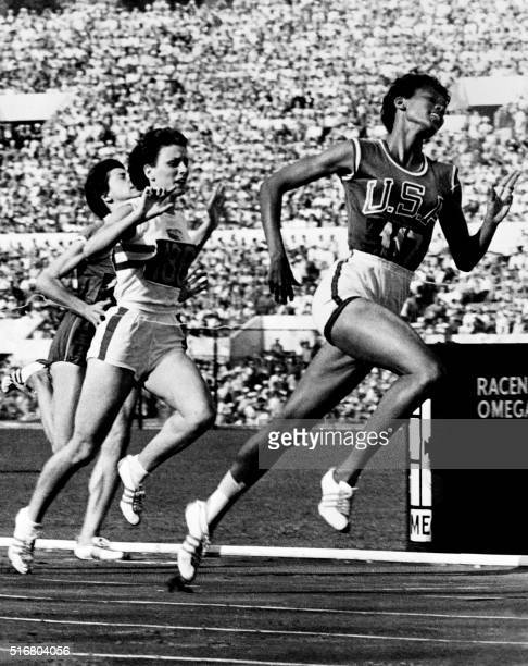 """Nicknamed """"the black gazelle"""", U.S champion Wilma Rudolph crosses the finish line of the Olympic 100m event, that she wins, establishing a new world..."""