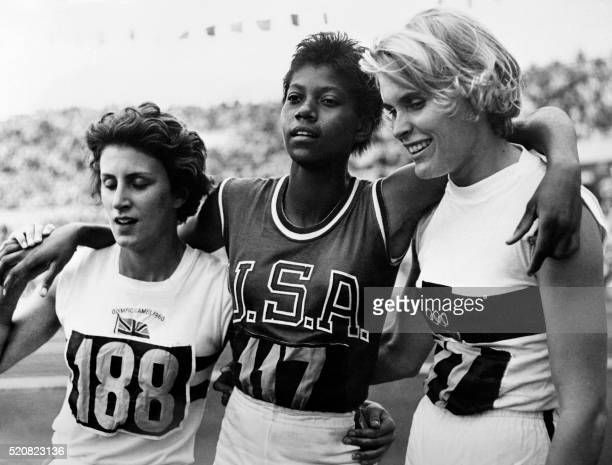 Nicknamed the black gazelle US champion Wilma Rudolph who have just won the Olympic 200m event pose between German Jutta Heine who finished 2nd and...