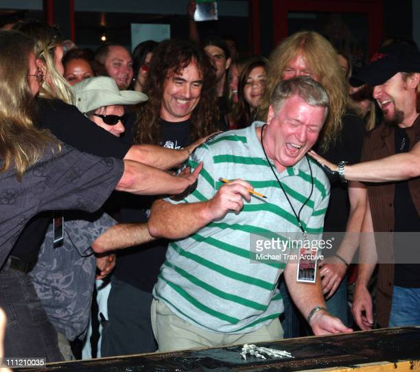 Nicko McBrain Bruce Dickinson Steve Harris Janick Gers and Adrian Smith of Iron Maiden with band manager Rod Smallwood