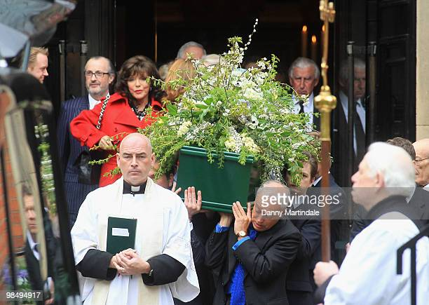 Nickolas Grace and the coffin bearers carry the coffin of Christopher Cazenove at his funeral held at St Paul's Church in Covent Garden on April 16...