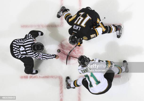 Nickolas Latta of the Sarnia Sting takes a faceoff against Chris Tierney of the London Knights during an OHL game at Budweiser Gardens on December 31...