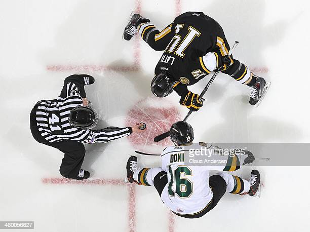 Nickolas Latta of the Sarnia Sting takes a faceoff against Max Domi of the London Knights during an OHL game at Budweiser Gardens on December 31 2013...
