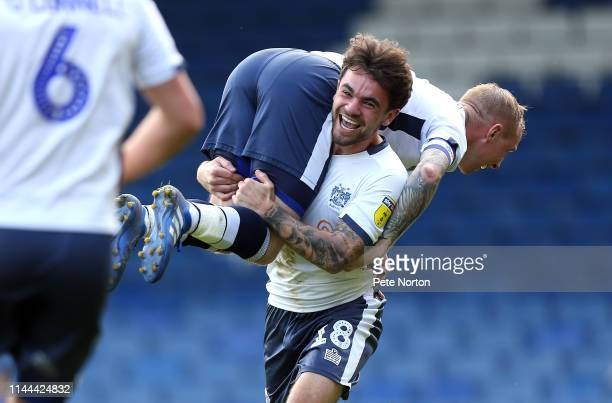 Nicky Adams of Bury is held head high by team mate Dom Telford as they celebrate a third goal scored by Nicky Maynard during the Sky Bet League Two...