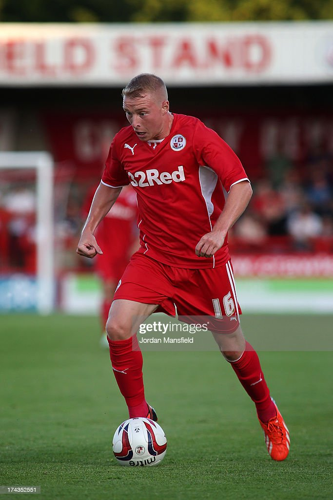 Nicky Adams of Crawley Town FC in action during the pre-season friendly against Brighton & Hove Albion at Broadfield Stadium on July 24, 2013 in Crawley, West Sussex.