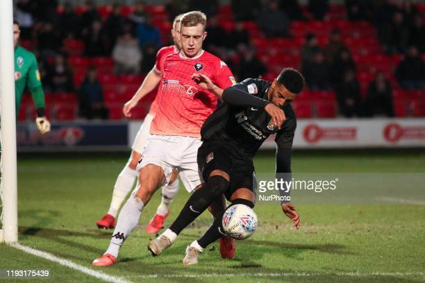 Nicky Adams of Northampton Town FC battles for possession with during the Sky Bet League 2 match between Salford City and Northampton Town at Moor...