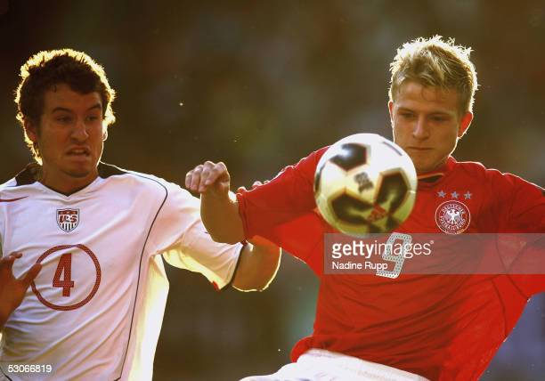 Nicky Adler of Germany is challenged by Nathan Sturgis of USA during the FIFA World Youth Championship match between Germany and USA on June 14, 2005...