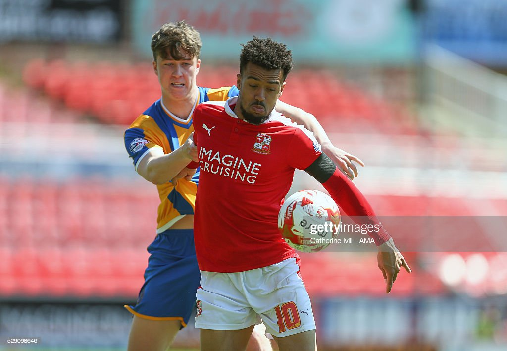 Nicky Ajose of Swindon Town and Jack Hendry of Shrewsbury Town during the Sky Bet League One match between Swindon Town and Shrewsbury Town at County Ground on May 8, 2016 in Swindon, England.