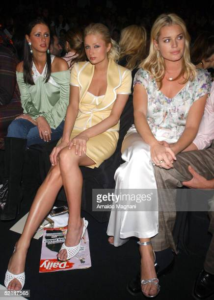 Nicky and Paris Hilton and Rebecca Romijn attend the Luca Luca Fall 2005 during Olympus Fashion Week at Bryant Park February 6 2005 in New York City