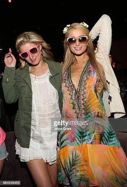 Nicky and Paris Hilton attend NYLON and Olay Fresh Effects present Neon Carnival with GUESS on April 12 2014 in Thermal California