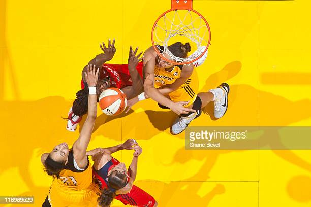 Nicky Anosike and Kelly Miller of the Washington Mystics battle with Liz Cambage and Jennifer Lacy of the Tulsa Shock for a loose ball under the hoop...