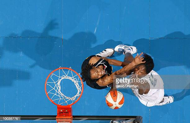 Nicky Anosike of the Minnesota Lynx battles for the rebound against Chante Black of the Tulsa Shock during the game on May 23 2010 at the Target...