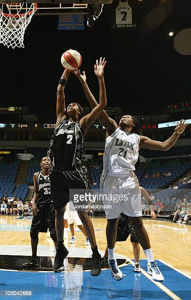 Nicky Anosike of the Minnesota Lynx fights for the rebound against Michelle Snow of the San Antonio Silver Stars during the game on July 22 2010 at...