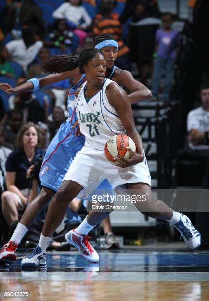 Nicky Anosike of the Minnesota Lynx goes for the basket against Michelle Snow of the Atlanta Dream during the game on July 15, 2009 at the Target...