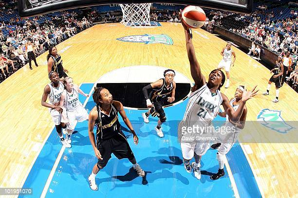Nicky Anosike of the Minnesota Lynx goes up for the ball against Chante Black of the Tulsa Shock during the WNBA game on May 23 2010 at Target Center...