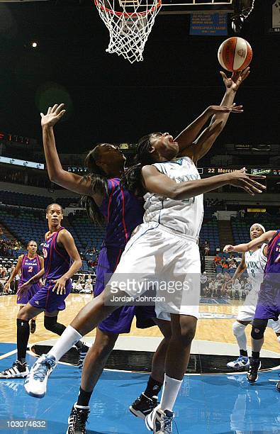 Nicky Anosike of the Minnesota Lynx goes up for the layup against Kara Braxton of the Phoenix Mercury during the game on July 24 2010 at the Target...