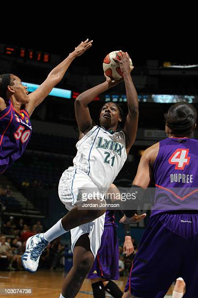 Nicky Anosike of the Minnesota Lynx puts up the shoot against Tangela Smith of the Phoenix Mercury during the game on July 24 2010 at the Target...