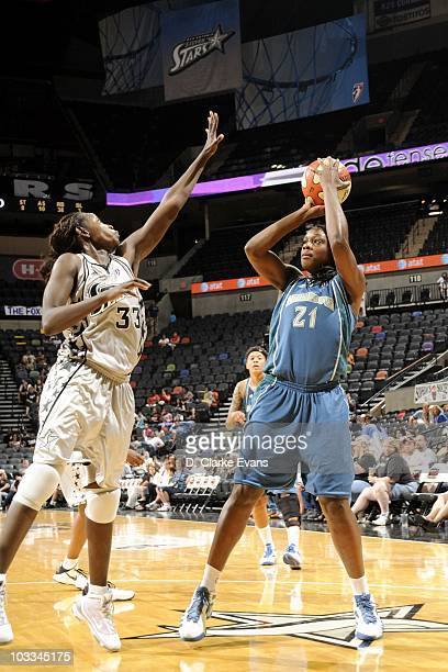 Nicky Anosike of the Minnesota Lynx shoots the ball against Sophia Young of the San Antonio Silver Stars during a WNBA game at the ATT Center on...