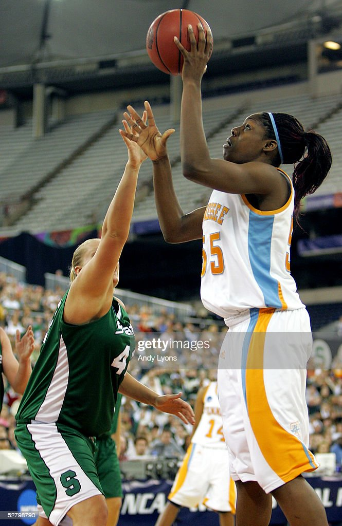 Nicky Anosike #55 of the Tennessee Lady Vols puts a shot up over Kelli Roehrig #42 of the Michigan State Spartans in the Semifinal game of the Women's NCAA Basketball Championship on April 3, 2005 at the RCA Dome in Indianapolis, Indiana. Michigan State defeated Tennessee 68-64.