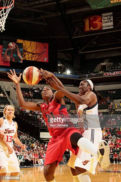 Nicky Anosike of the Washington Mystics battles Jessica Davenport of the Indiana Fever at Conseco Fieldhouse on July 9 2011 in Indianapolis Indiana...