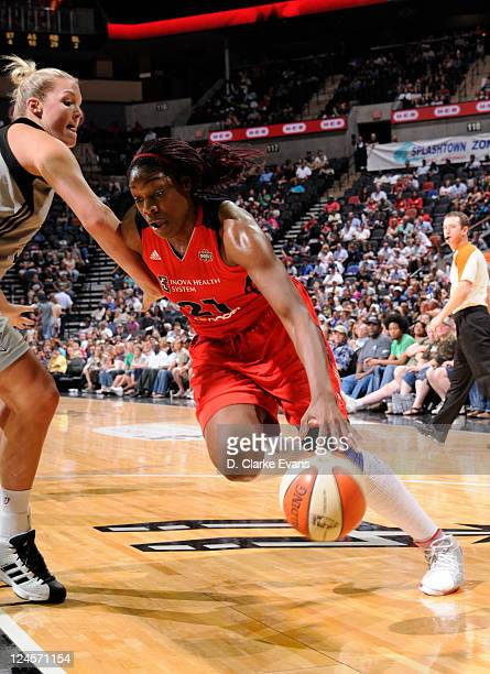 Nicky Anosike of the Washington Mystics drives against Jayne Appel of the San Antonio Silver Stars at the ATT Center on September 10 2011 in San...