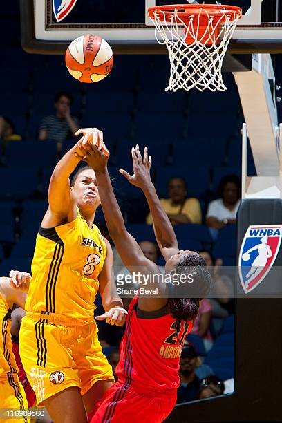 Nicky Anosike of the Washington Mystics has a shot blocked by Liz Cambage of the Tulsa Shock during the WNBA game on June 18 2011 at the BOK Center...