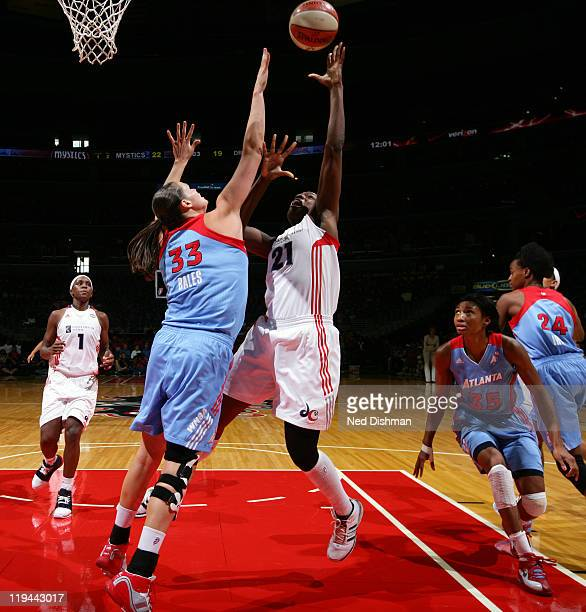 Nicky Anosike of the Washington Mystics shoots against Alison Bales of the Atlanta Dream at the Verizon Center on July 20 2011 in Washington DC NOTE...