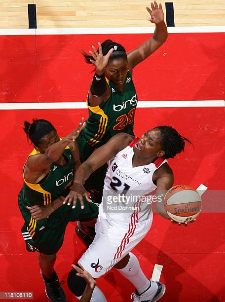 Nicky Anosike of the Washington Mystics shoots against Swin Cash of the Seattle Storm at the Verizon Center on July 3 2011 in Washington DC NOTE TO...