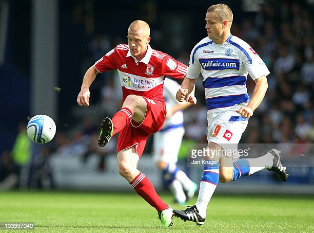 Nicky Bailey of Middlesbrough battles with Heidar Helguson of Queens Park Rangers during the npower Championship match between Queens Park Rangers...
