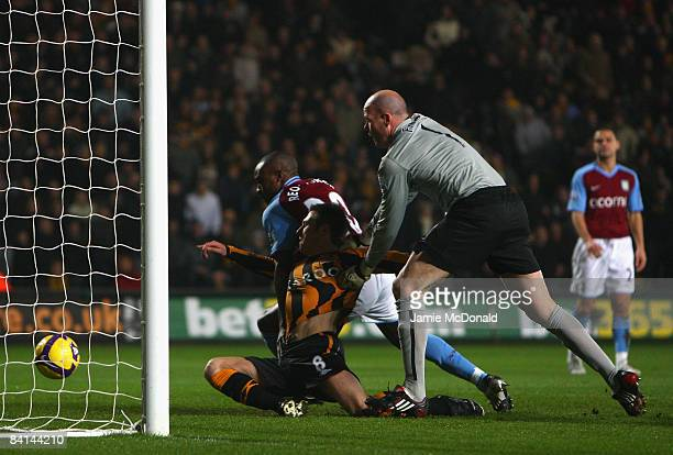 Nicky Barmby of Hull City scores a disallowed goal as he tangles with Brad Friedel and Nigel Reo-Coker of Aston Villa during the Barclays Premier...