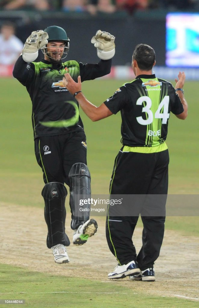 Nicky Boje (R) celebrates the wicket of Graham Manou with team-mate Mark Boucher during the Airtel Champions League Twenty20 semi final match between South Australian Redbacks and Chevrolet Warriors at SuperSport Park on September 25, 2010 in Pretoria, South Africa.