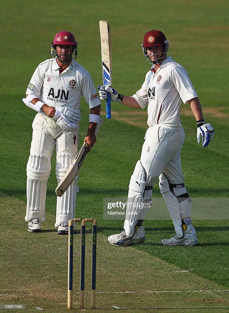 Nicky Boje of Northamptonshire congratulates Mal Loye on his century during the LV County Championship match between Northamptonshire and Surrey at the County Ground on May 24, 2010 in Northampton, England.