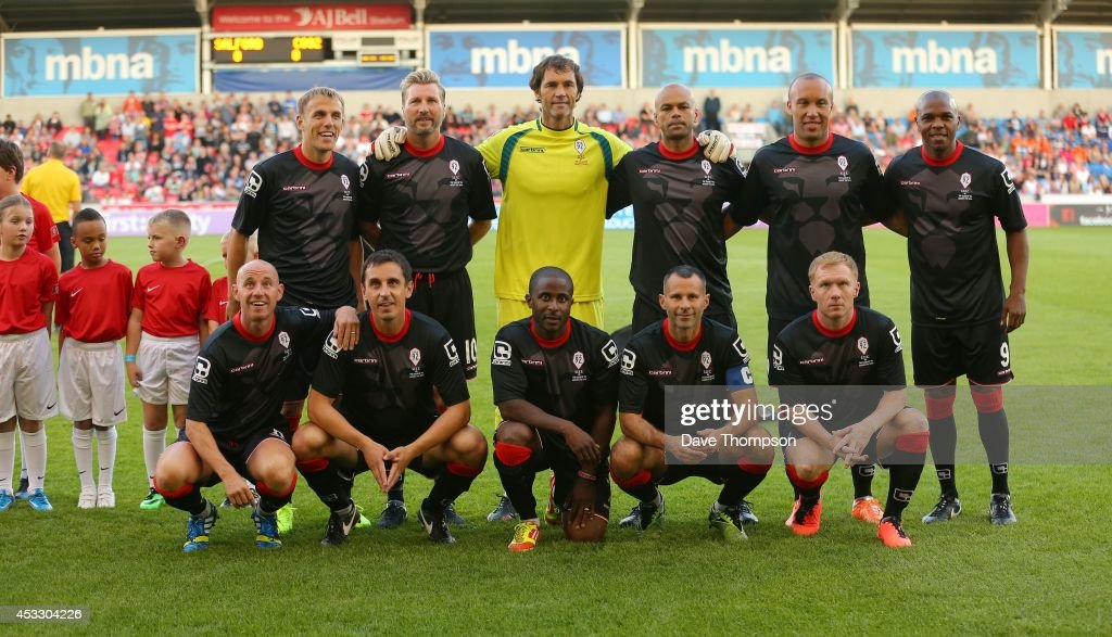 Nicky Butt, Gary Neville, Raphael Burke, Ryan Giggs, Paul Scholes and (Back Row L-R) Phil Neville, Robbie Savage, Raimond van der Gouw, John O'Kane, Mikael Silvestre,Quinton Fortune of the Class of 92 squad line up before the match between Salford City and the Class of '92 XI at AJ Bell Stadium on August 7, 2014 in Salford, England.