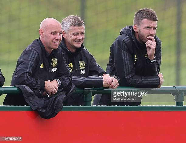 Nicky Butt Manager Ole Gunnar Solskjaer and Coach Michael Carrick of Manchester United watch from the touchline during the U18 Premier League match...