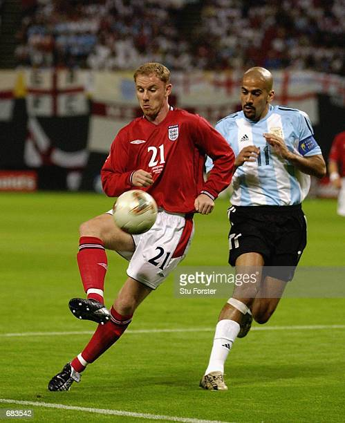 Nicky Butt of England takes on Juan Veron of Argentina during the England v Argentina Group F World Cup Group Stage match played at the Sapporo Dome...