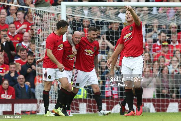 Nicky Butt of Manchester United '99 Legends celebrates scoring his team's third goal during the 20 Years Treble Reunion match between Manchester...