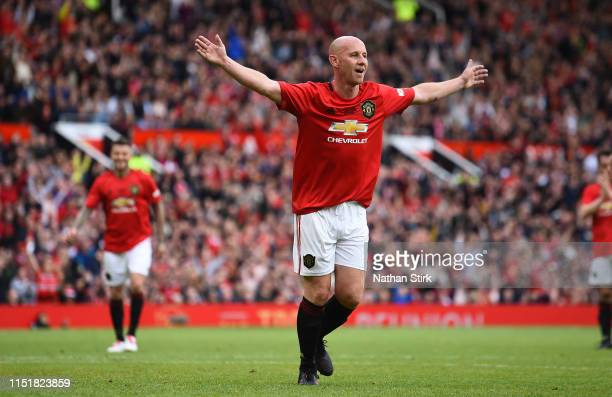 Nicky Butt of Manchester United celebrates after scoring during the Manchester United '99 Legends and FC Bayern Legends at Old Trafford on May 26...