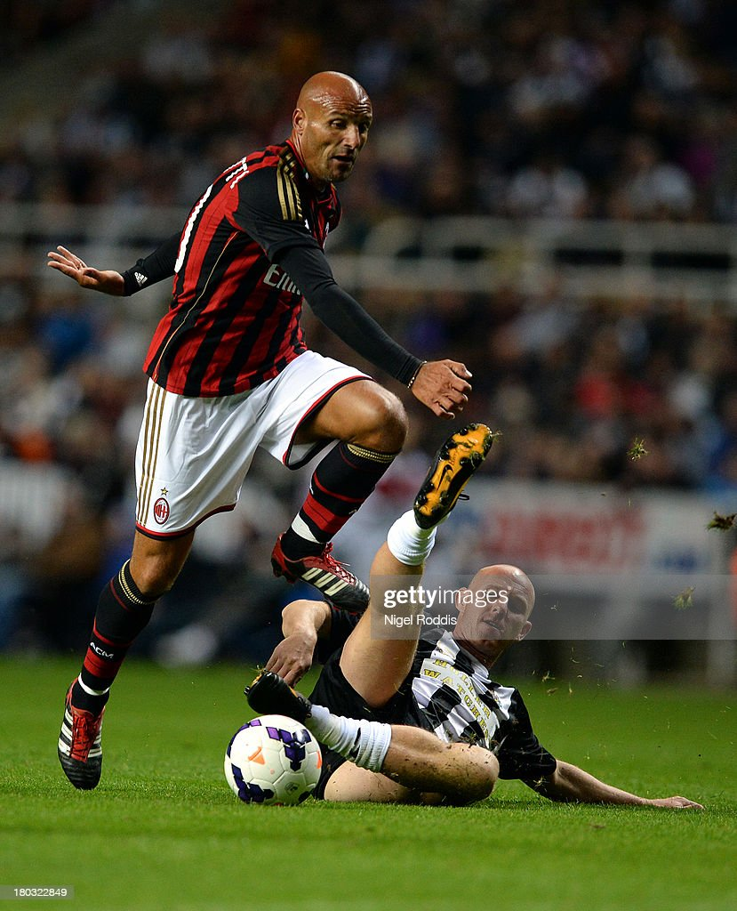 Nicky Butt (R) of Newcastle United vies for the ball with Christian Lantignotti (L) of AC Milan Glorie during Steve Harper's testimonial match between Newcastle United and AC Milan Glorie at St James' Park on September 11, 2013 in Newcastle upon Tyne, England.