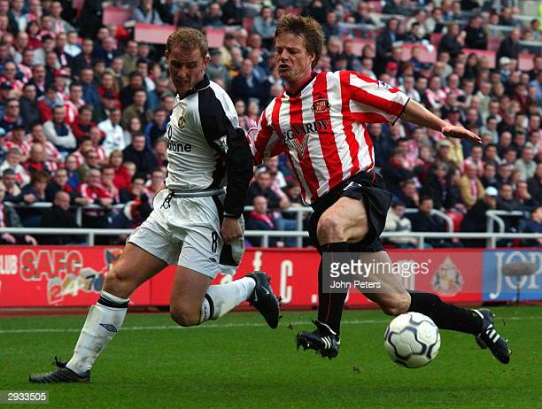 Nicky Butts challenges Stephen Schwarz for the ball during the FA Barclaycard Premiership match between Sunderland v Manchester United at the Stadium...