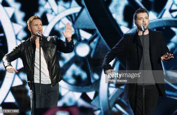 Nicky Byrne and Mark Feehily from Westlife perform at annual children's charity concert 'Cheerios Childline Concert' at O2 on November 12 2011 in...