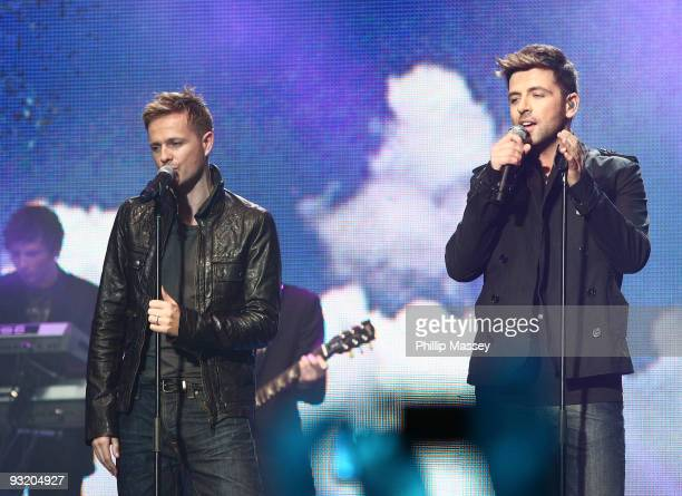 Nicky Byrne and Mark Feehily from Westlife perform at the Cheerio's Childline Concert on November 18 2009 in Dublin Ireland