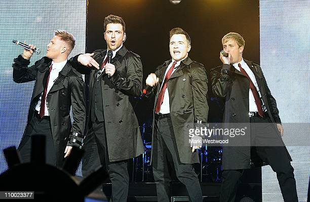 Nicky Byrne Chris Feehily Shane Filan and Kian Egan of Westlife perform on stage at O2 Arena on March 11 2011 in London United Kingdom