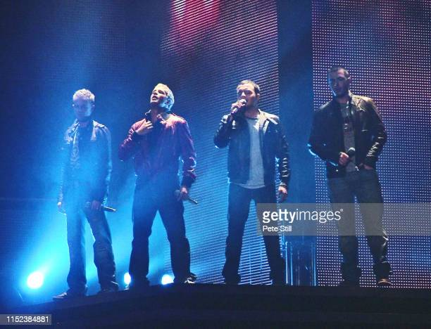 Nicky Byrne Kian Egan Shane Filan and Mark Feehily of Irish boy band Westlife perform on stage at Hammersmith Odeon on March 29th 2008 in London...