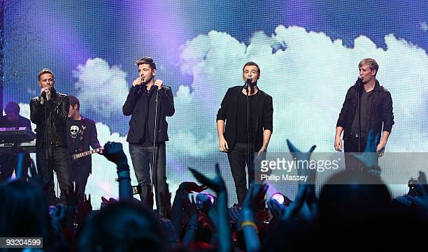 Nicky Byrne Mark Feehily Shane Filan and Kian Egan from Westlife perform at the Cheerio's Childline Concert on November 18 2009 in Dublin Ireland