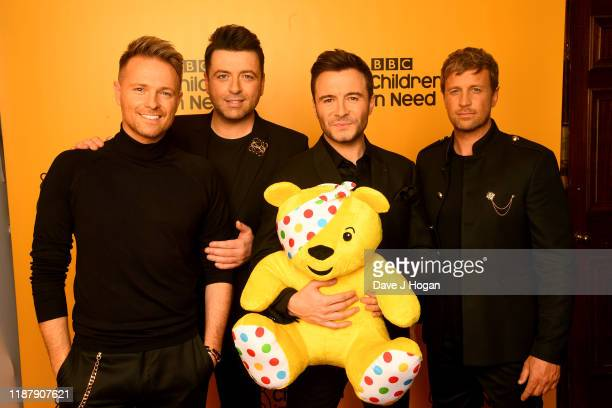 Nicky Byrne Mark Feehily Shane Filan and Kian Egan of Westlife backstage at BBC Children in Need's 2019 Appeal night at Elstree Studios on November...