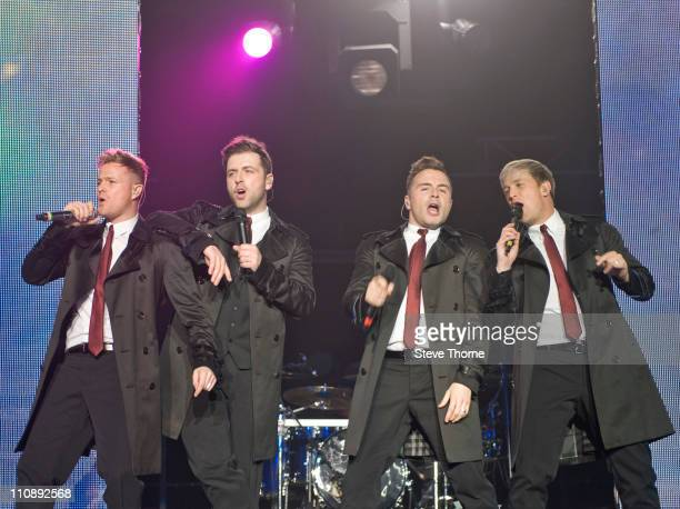 Nicky Byrne Mark Feehily Shane Filan and Kian Egan of Westlife perform on stage at LG Arena on March 25 2011 in Birmingham United Kingdom