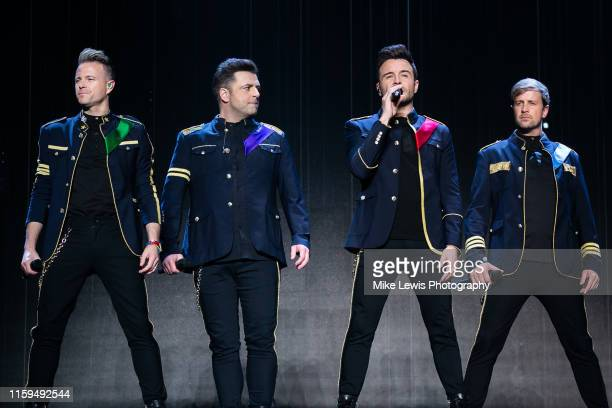Nicky Byrne, Markus Feehily, Shane Filan and Kian Egan of Westlife perform on stage at Motorpoint Arena on July 01, 2019 in Cardiff, Wales.